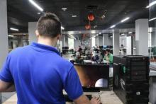 Technician Eric Olson sets up the Oculus Rift